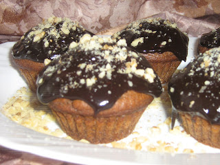 Muffins, topped with chocolate and nuts, mafini, cupcakes