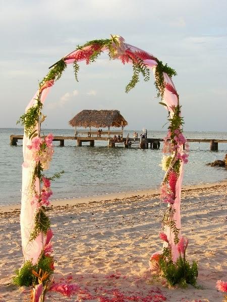 Destination Beach Wedding Ideas: Hot Pink Beach Wedding Arch