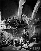 Pablo Picasso painting with light in 1949.