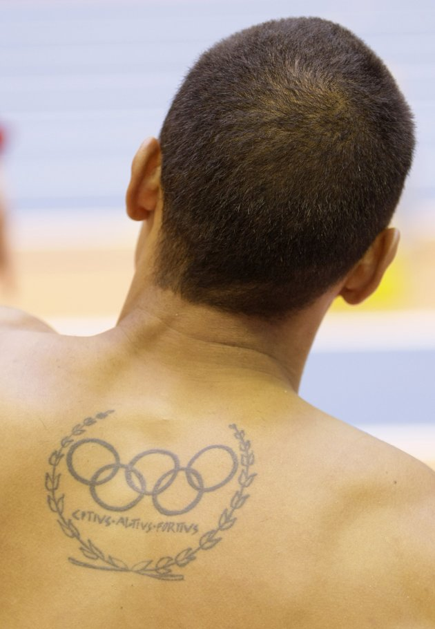 Anyten 10 tattoos of an olympic athletes for Track and field tattoos