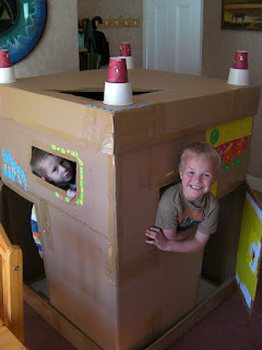 giant cardboard box used as childrens playhouse