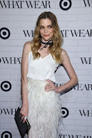 Jaime King in feather skirt over a silk white top paired at the Who What Wear x Target Launch Party red carpet dress