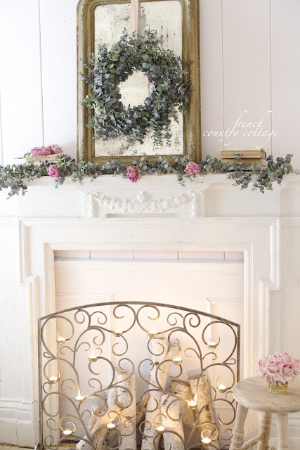 Faux fireplace mantel with eucalyptus and tea light screen