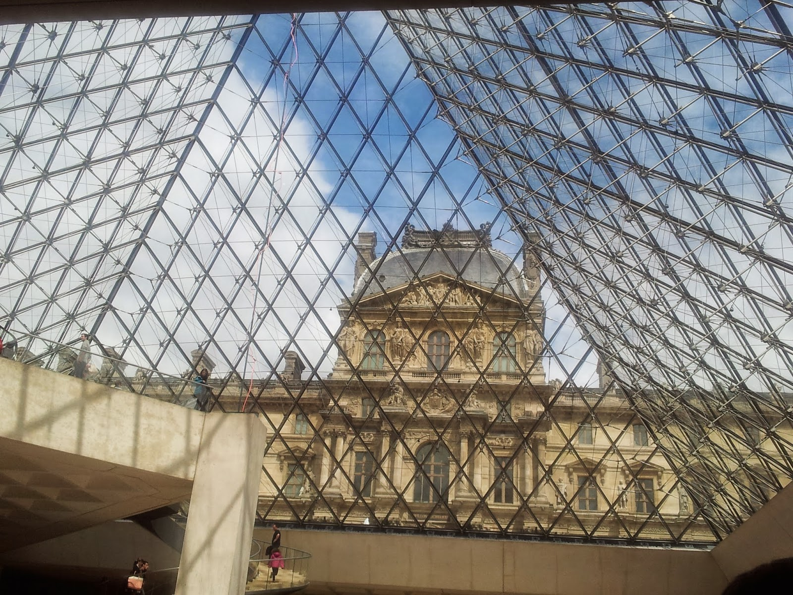 Looking out under the glass at the Louvre, Paris.