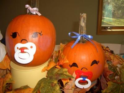 You can create a pumpkin cake with a baby popping out.