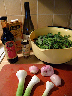 Bowl of Kale Strips, Condiments, and Green Garlic and Shallots on Cutting Board