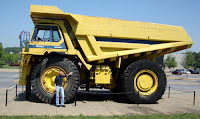 Travis next to the Tonka Truck