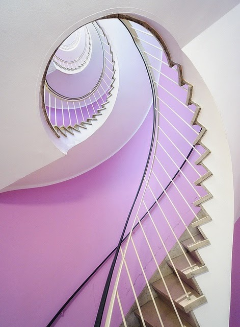 concrete spiral stairs, with metal handrails