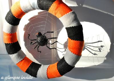 http://www.aglimpseinsideblog.com/2011/09/spider-web-halloween-wreath.html