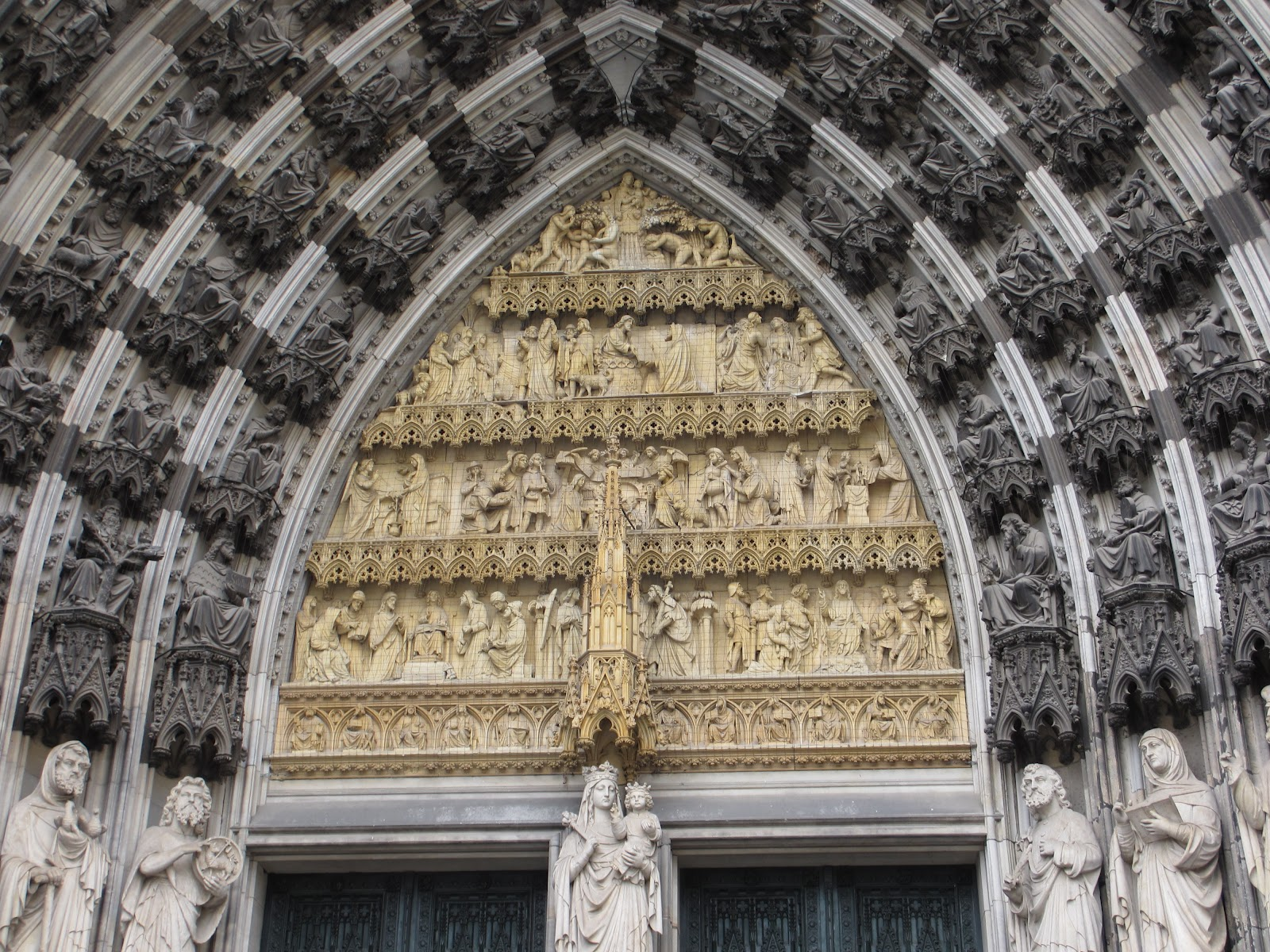 The center portal has two doors with Mary as the main figure just visible below with the tympanum and archivolts above her. & Cannundrums: Cologne Cathedral