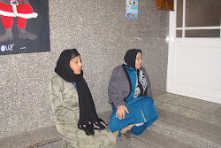These women are waiting to receive their aid packages