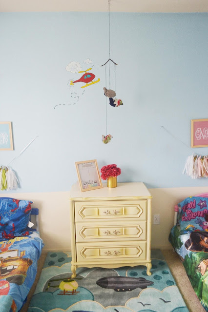 Eclectic DIY and thrifted kids room with tassel garland made with tissue paper