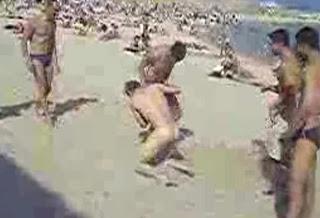 Guy Pantsed At Beach