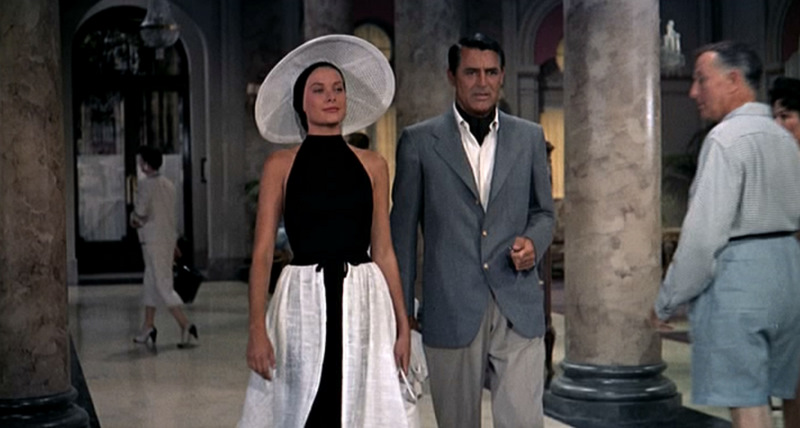 A still from the movie _To Catch A Thief_ featuring Grace Kelly and Cary Grant. The bottom button of Grant's jacket is--horror of horrors--buttoned.