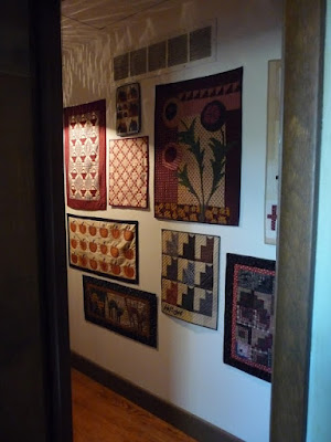 Small Quilts on a Hallway Wall