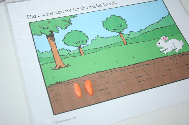 The idea is to make little carrots from the playdough. this is