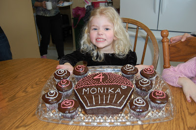 birthday girl with cake and cupcakes