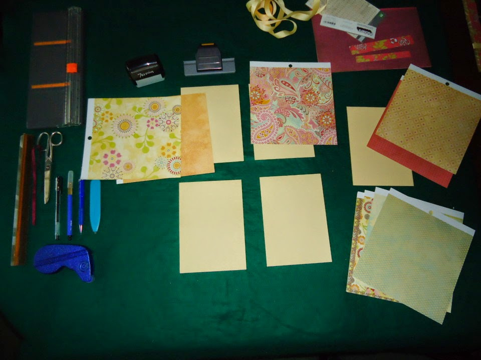 "Assorted crafting materials spread on a green table top.  Gathering materials for ""Serial Method"" of crafting @ATIPicalDay #crafting #serialmethod #organizingmaterials"