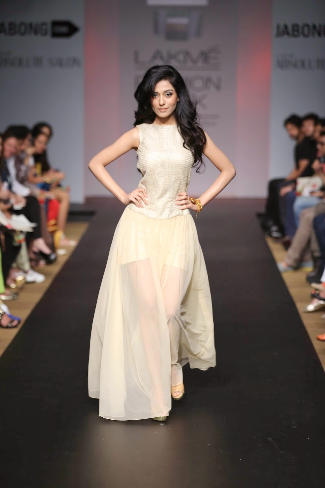 The showstopper, Bollywood star pretty and petit Amrita Rao graced the runway in a gorgeous shimmering dress with see-through material used for gathers at the bottom.