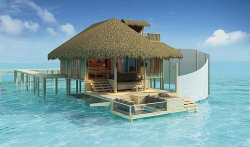 Strandhaus am meer  Die schönsten Strandhäuser: Kleines Strandhaus mitten im türkisen Meer