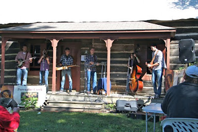 Porcupine Creek bluegrass band on log house porch