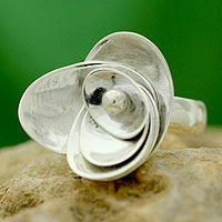 http://jewelry.novica.com/rings/cocktail/sterling-silver/sterling-silver-flower-ring-lotus-majesty/190971/
