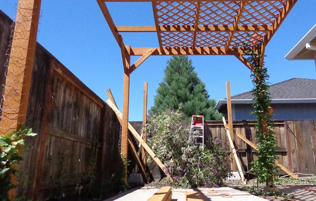 how to build a triangular pergola attached to a house