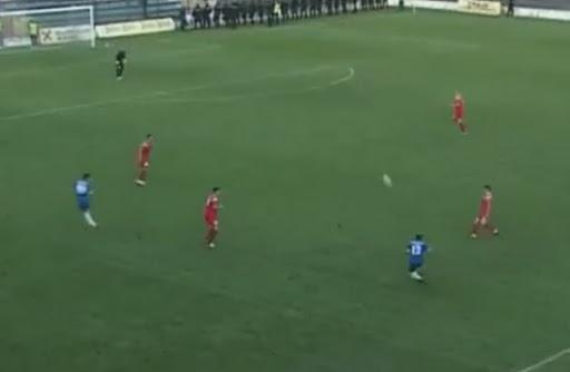 Smederevo player Dejan Živković shoots from halfway-line to score against Radnički