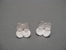 Four circle earrings, silver £57