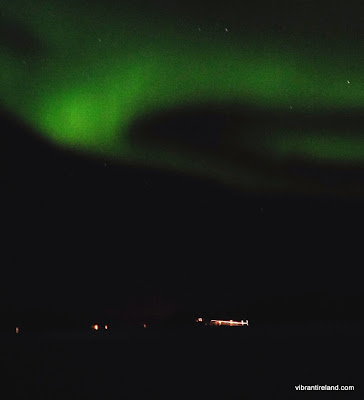 northern lights over the fjord, vagnes, norway