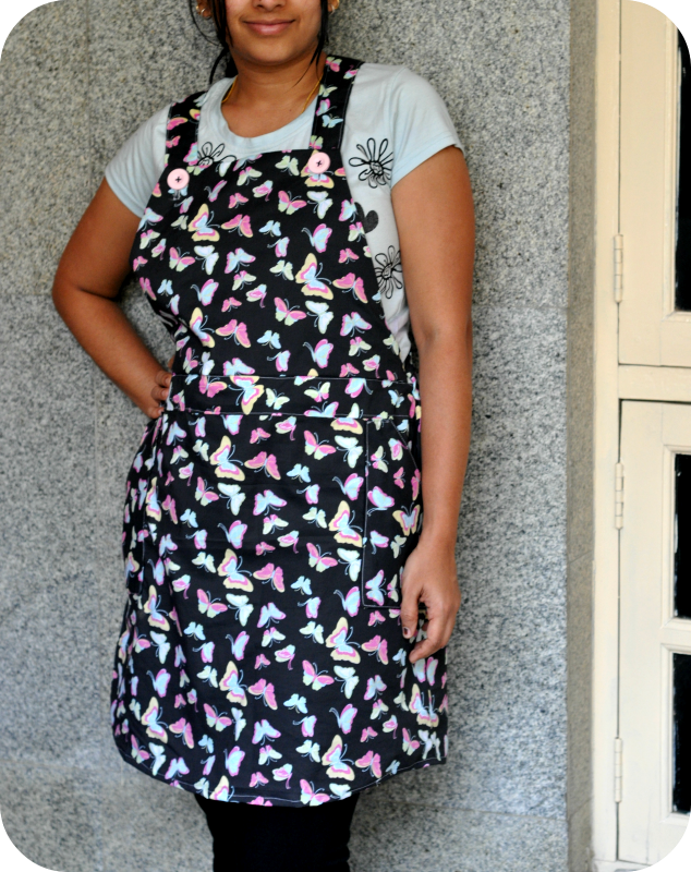 Jumper dress pinafore dress style with straps waistband and pockets made from cotton printed fabric
