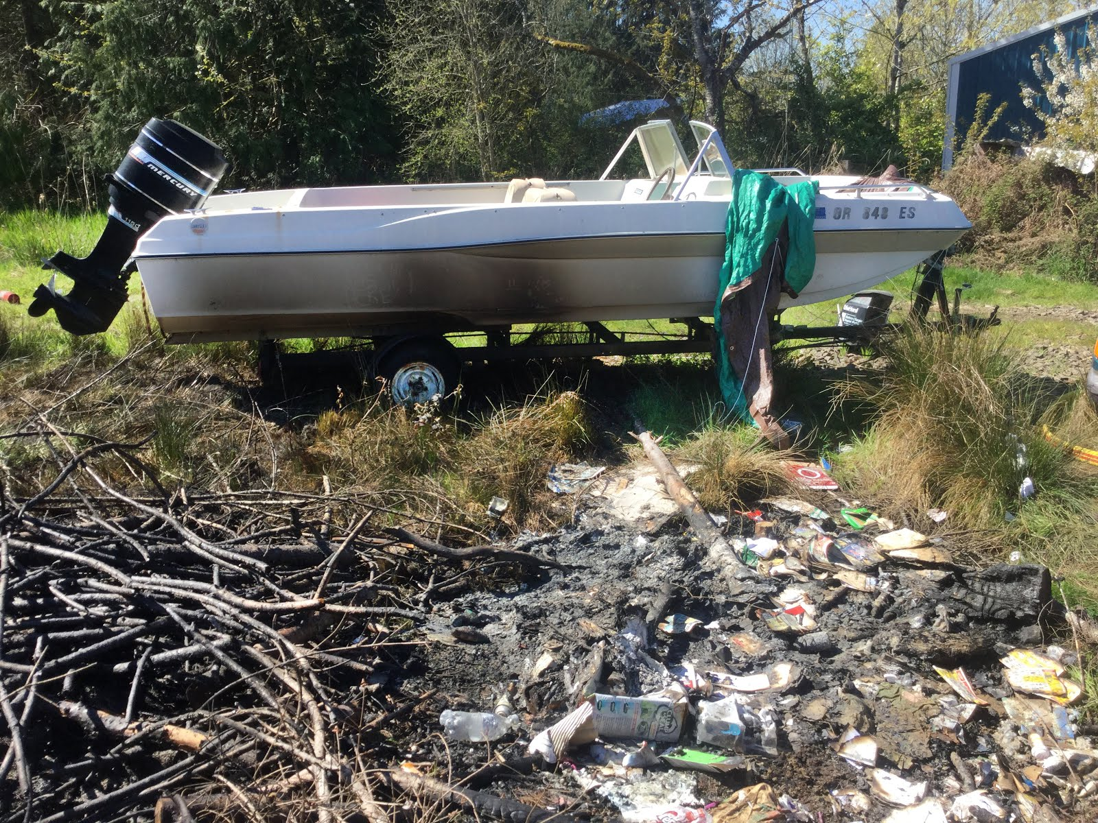 Debris burn damages boat