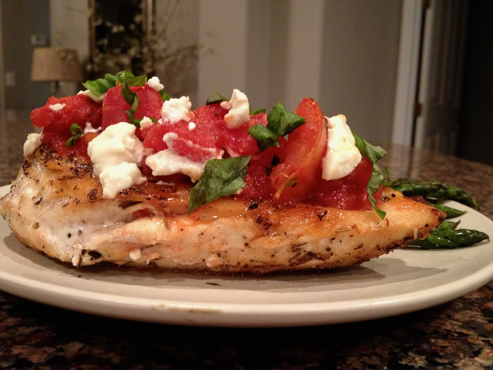 ... , but smothered in fire roasted tomatoes, goat cheese and basil. Yum
