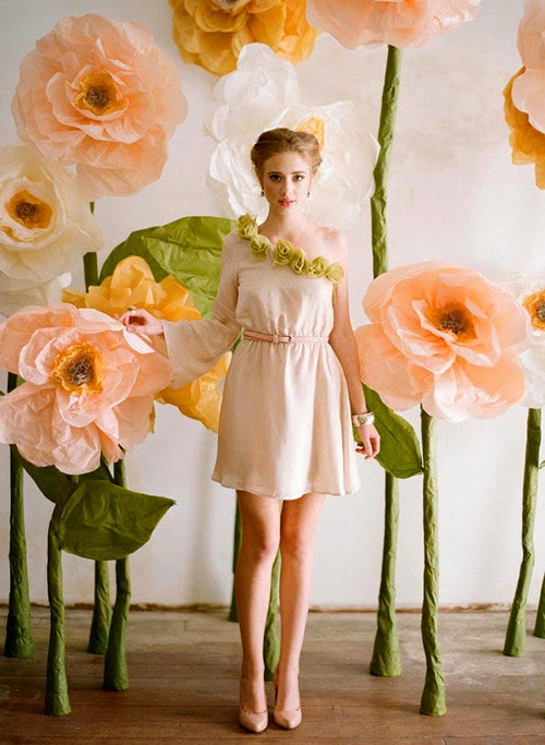 http://www.designsponge.com/2012/02/diy-project-giant-paper-flowers-from-ruche.html