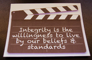 "Photo of paper illustration with ""Integrity is the willingness to live by our beliefs & standards"" legend"