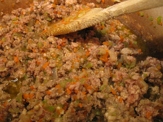 close up of meat sauce in pot