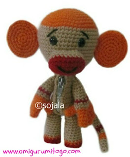 orange and beige crochet sock monkey