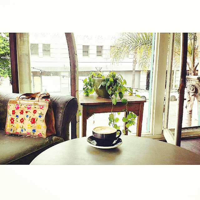 Stumptown Coffee Roasters Long Beach, vintage purse, green couch, window, Cappucino, See Summer Better, Warby Parker