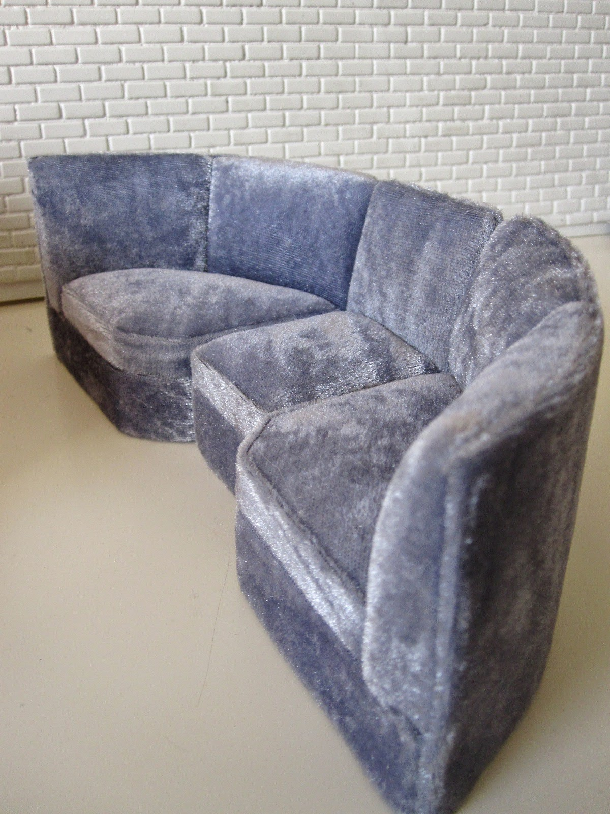Modern miniature three piece grey velvet booth seating.