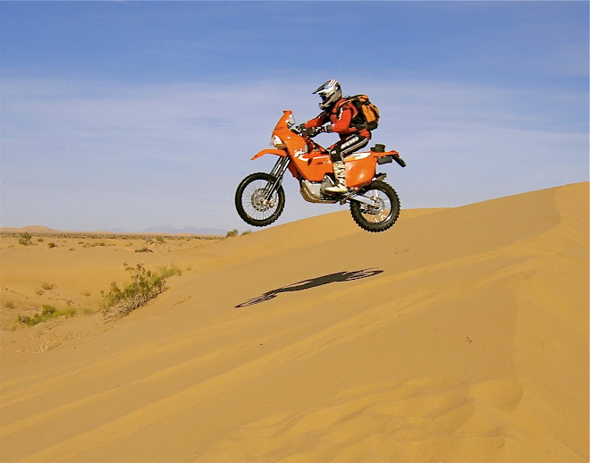 My feeble attempt at big air in the dunes.