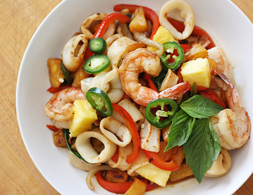 lisa is cooking spicy squid and shrimp stir fry