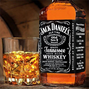 Jack Daniel's whiskey bottle and glass on the rocks