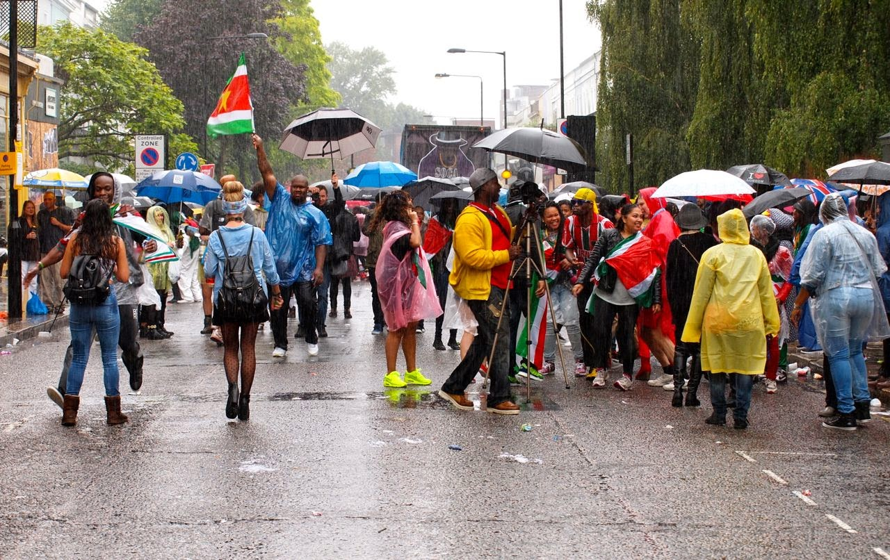 Revellers undeterred by non-stop rain at London's 2014 Notting Hill Carnival