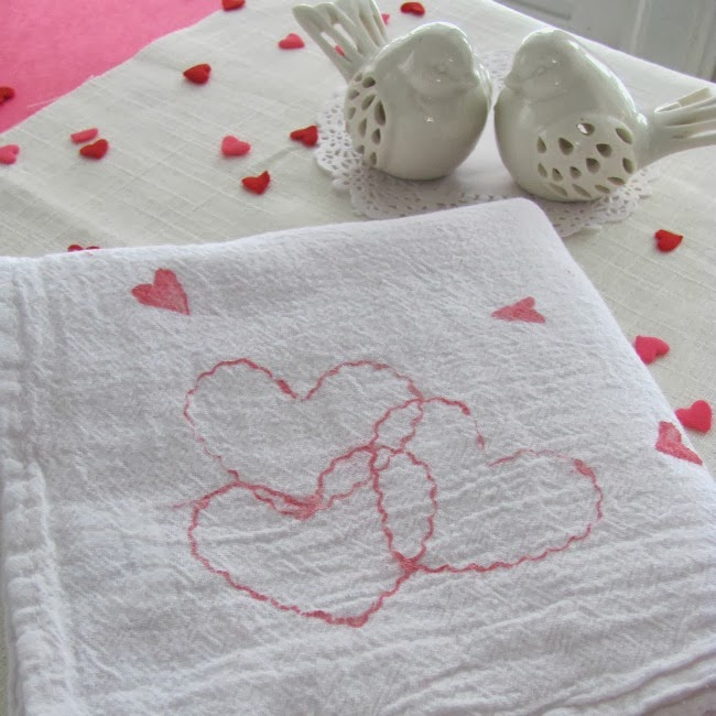 pink hearts stamped on flour sack towels