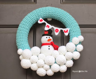 http://www.repeatcrafterme.com/2013/11/crocheted-snowball-wreath.html
