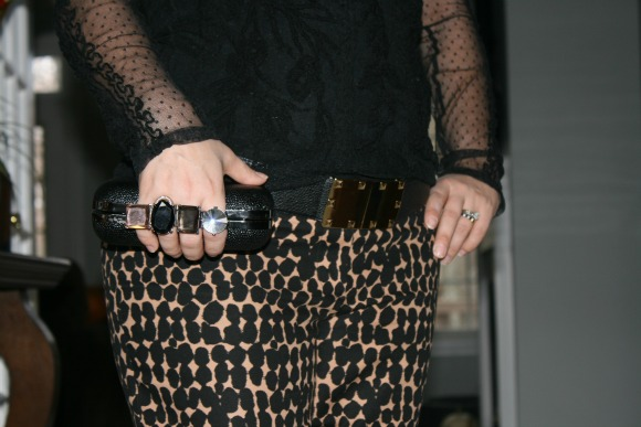 Sheer Black Embroidered Blouse from Zara, Tiger Print Pants from Loft, Jewel and Metal Closure Clutch from South Moon Under, Gold Studded Waist Belt from BCBGMAXAZRIA