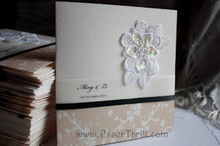 Printed floral with embroidered flower wedding card