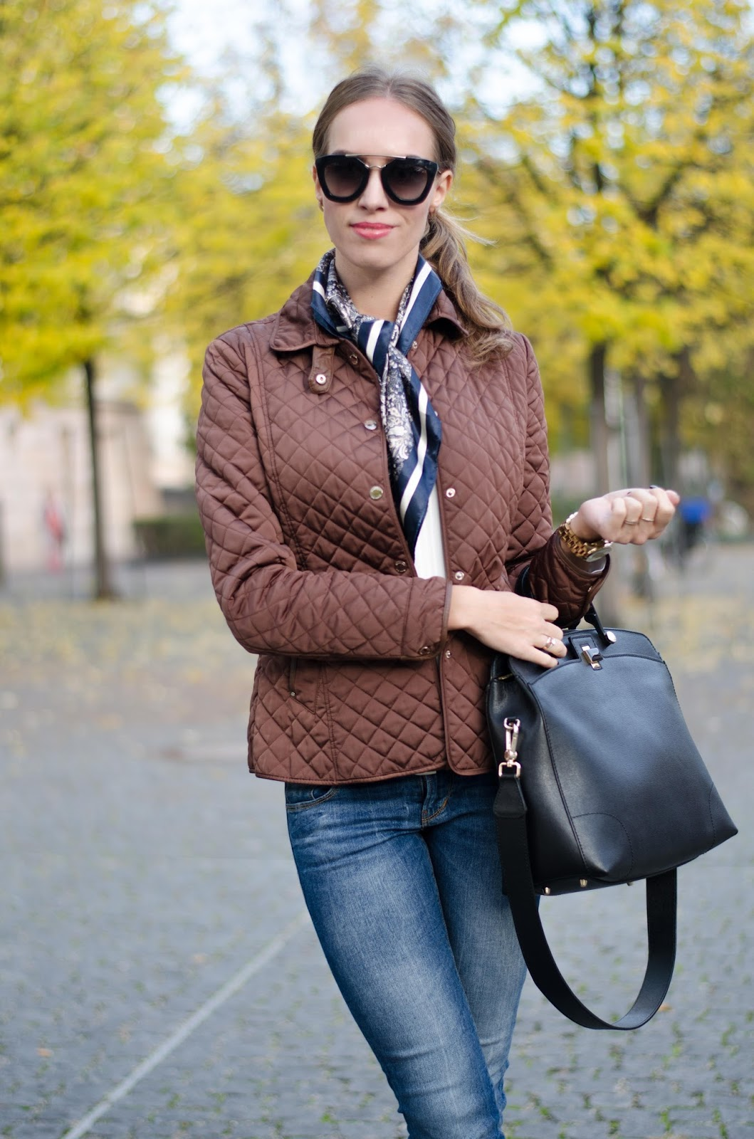 kristjaana mere fall outfit furla black bag guess blue jeans massimo dutti brown quilted jacket lindex blue silk scarf