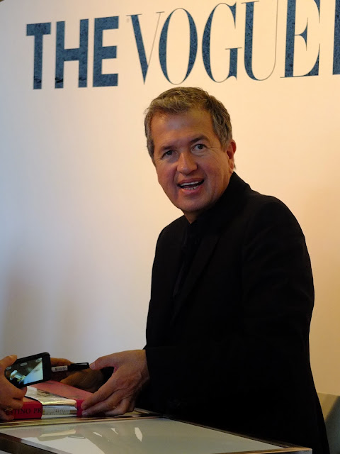 mario Testino signing his book at Vogue festival.