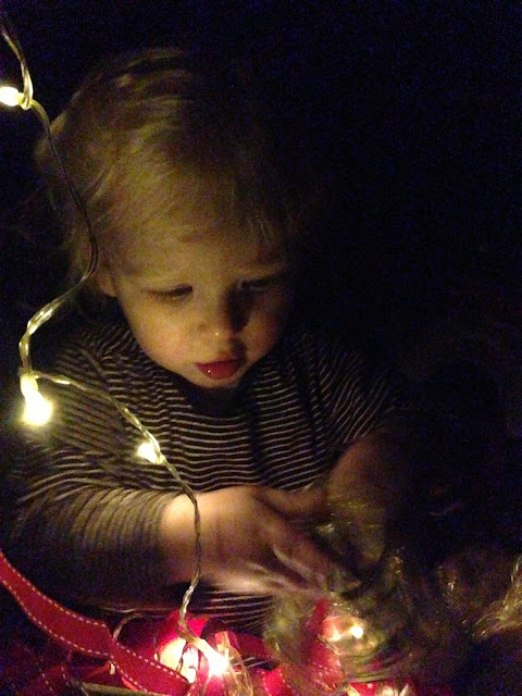 Toddler investigating Christmas Decorations